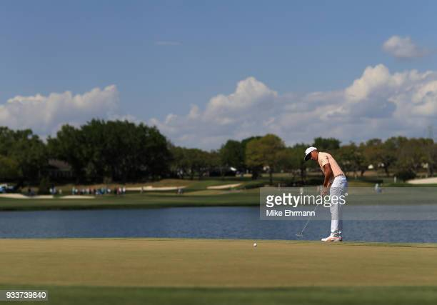 Rickie Fowler putts on the sixth hole during the final round at the Arnold Palmer Invitational Presented By MasterCard at Bay Hill Club and Lodge on...