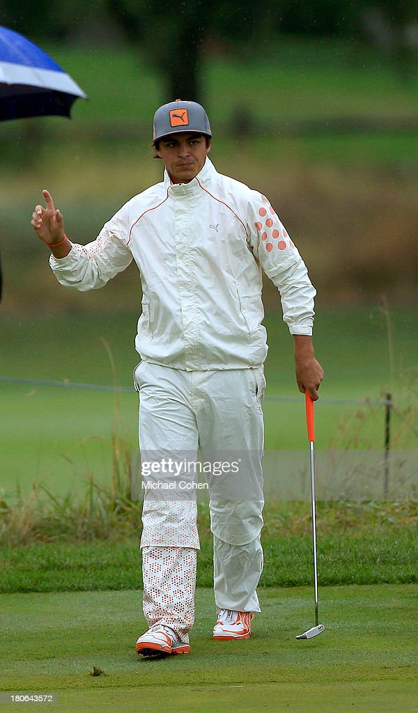 Rickie Fowler reacts after a putt on the third green during the Final Round of the BMW Championship at Conway Farms Golf Club on September 15, 2013 in Lake Forest, Illinois.
