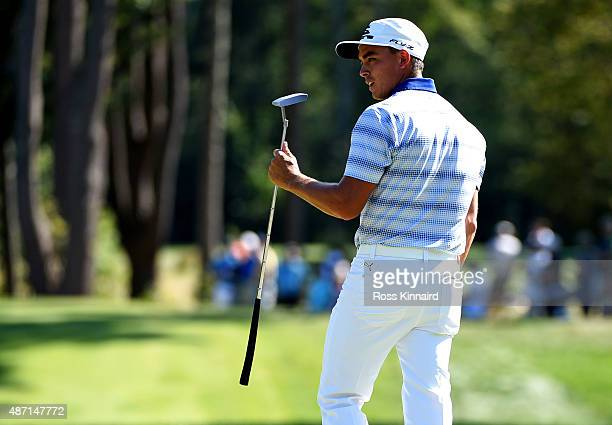 Rickie Fowler reacts after his putt on the seventh hole during round three of the Deutsche Bank Championship at TPC Boston on September 6, 2015 in...