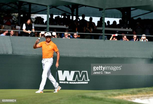 Rickie Fowler reacts after making his birdie putt on the 16th green during the final round of the Waste Management Phoenix Open at TPC Scottsdale on...