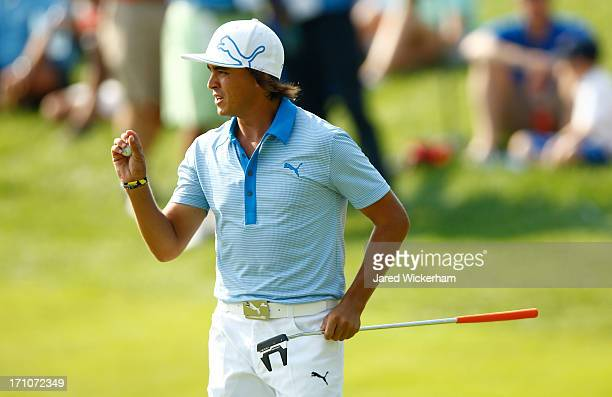 Rickie Fowler reacts after missing a putt on the 18th hole during the second round of the 2013 Travelers Championship at TPC River Highlands on June...
