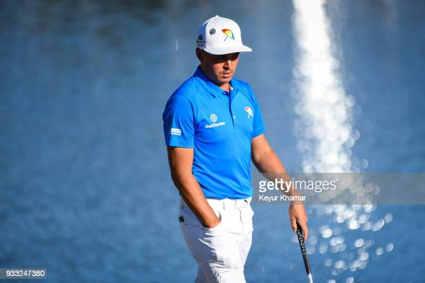 Rickie Fowler reacts and walks to his ball on the 18th hole green during the third round of the Arnold Palmer Invitational presented by MasterCard at...