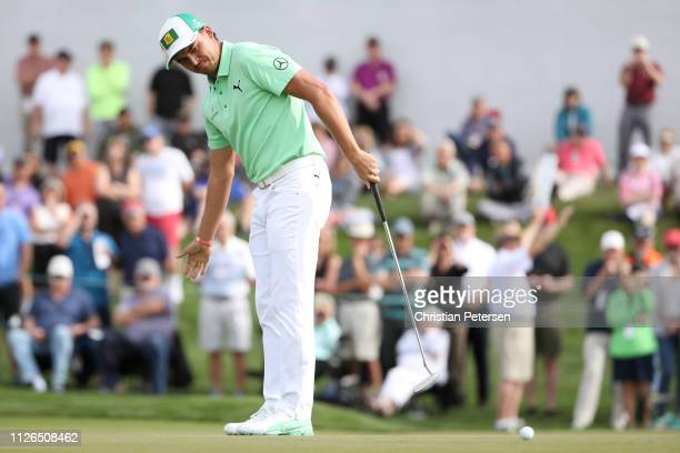 Rickie Fowler reacts following a putt on the second green during the first round of the Waste Management Phoenix Open at TPC Scottsdale on January...