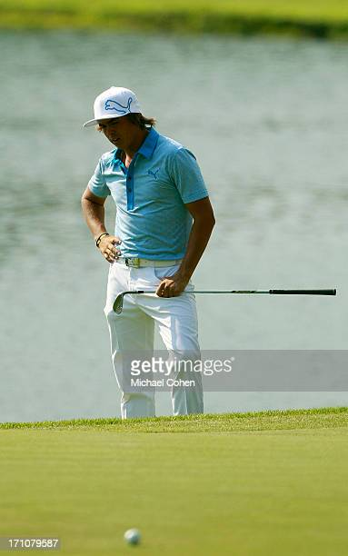 Rickie Fowler reacts to his missed chip on the 15th green during the second round of the Travelers Championship held at TPC River Highlands on June...