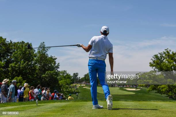 Rickie Fowler reacts to his tee shot on the 10th hole during the third round of the Memorial Tournament presented by Nationwide at Muirfield Village...