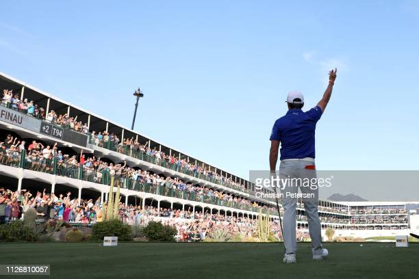 Rickie Fowler reacts with the gallery on the 16th tee during the second round of the Waste Management Phoenix Open at TPC Scottsdale on February 01...