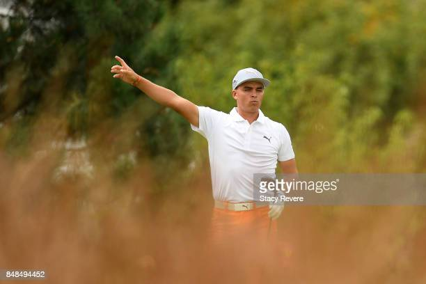 Rickie Fowler signals an errant tee shot on the fourth hole during the final round of the BMW Championship at Conway Farms Golf Club on September 17,...