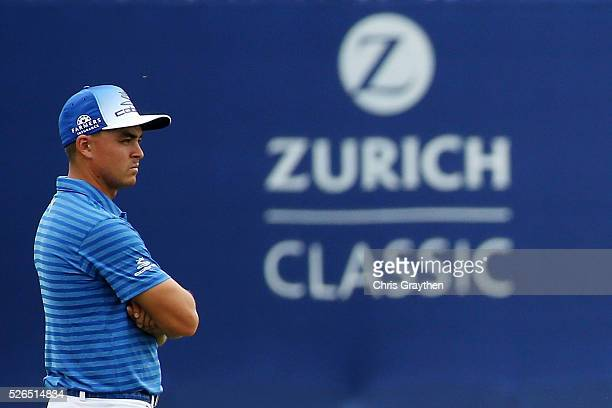 Rickie Fowler stands on the 18th green during the continuaiton of the second round of the Zurich Classic of New Orleans at TPC Louisiana on April 30,...