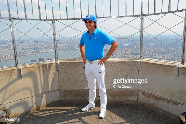 Rickie Fowler stops by the Empire State Building and flips the switch to turn the building Barclays blue before the start of The Barclays at Liberty...