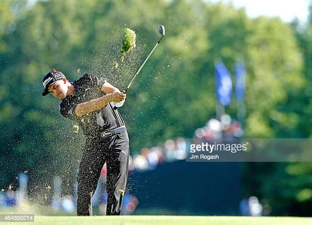 Rickie Fowler takes his shot on the 10th hole hole during the first round of the Deutsche Bank Championship at the TPC Boston on August 29 2014 in...