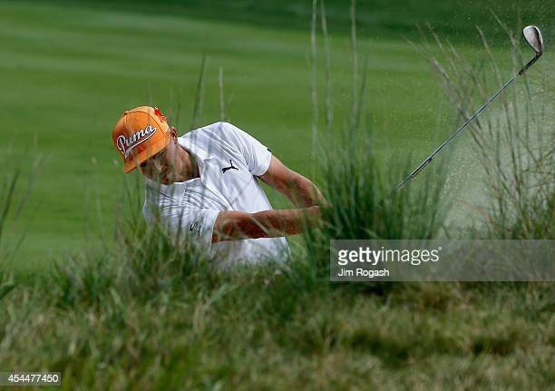 Rickie Fowler takes his shot on the first hole during the final round of the Deutsche Bank Championship at the TPC Boston on September 1 2014 in...
