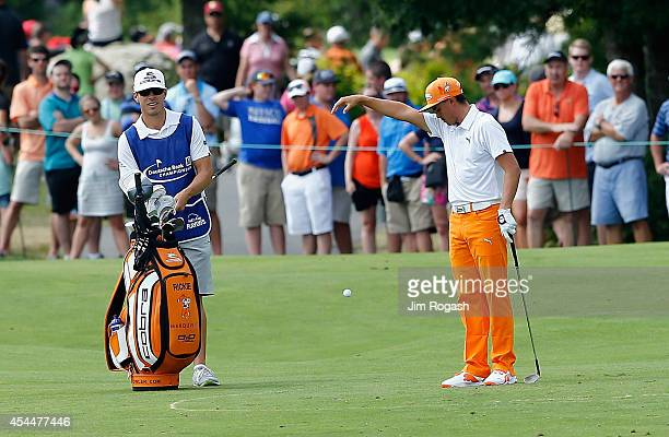 Rickie Fowler takes takes a ball drop on the second hole during the final round of the Deutsche Bank Championship at the TPC Boston on September 1...