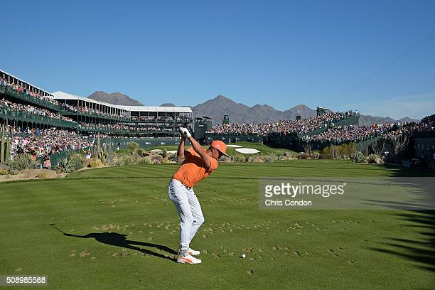 Rickie Fowler tees off on the 16th hole during the final round of the Waste Management Phoenix Open at TPC Scottsdale on February 7 2016 in...