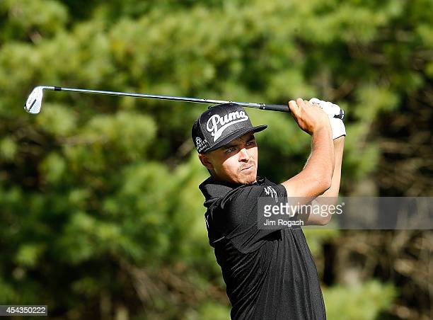 Rickie Fowler tees off on the 17th hole during the first round of the Deutsche Bank Championship at the TPC Boston on August 29 2014 in Norton...