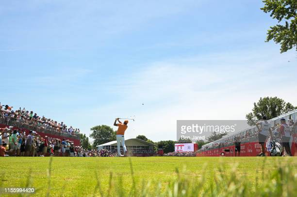 Rickie Fowler tees off on the fifteenth tee box during the final round of the Rocket Mortgage Classic at Detroit Golf Club on June 30, 2019 in...