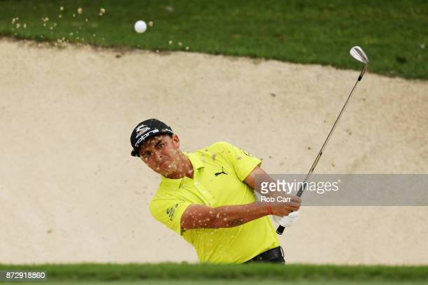 Rickie Fowler the United States plays a shot from a bunker on the 18th hole during the continuation of the second round of the OHL Classic at...