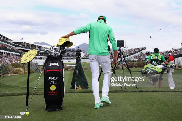 SCOTTSDALE ARIZONA FEBRUARY Rickie Fowler touches a temporary memorial to the late PGA pro Jarrod Lyle as he walks up to the 16th tee during the...