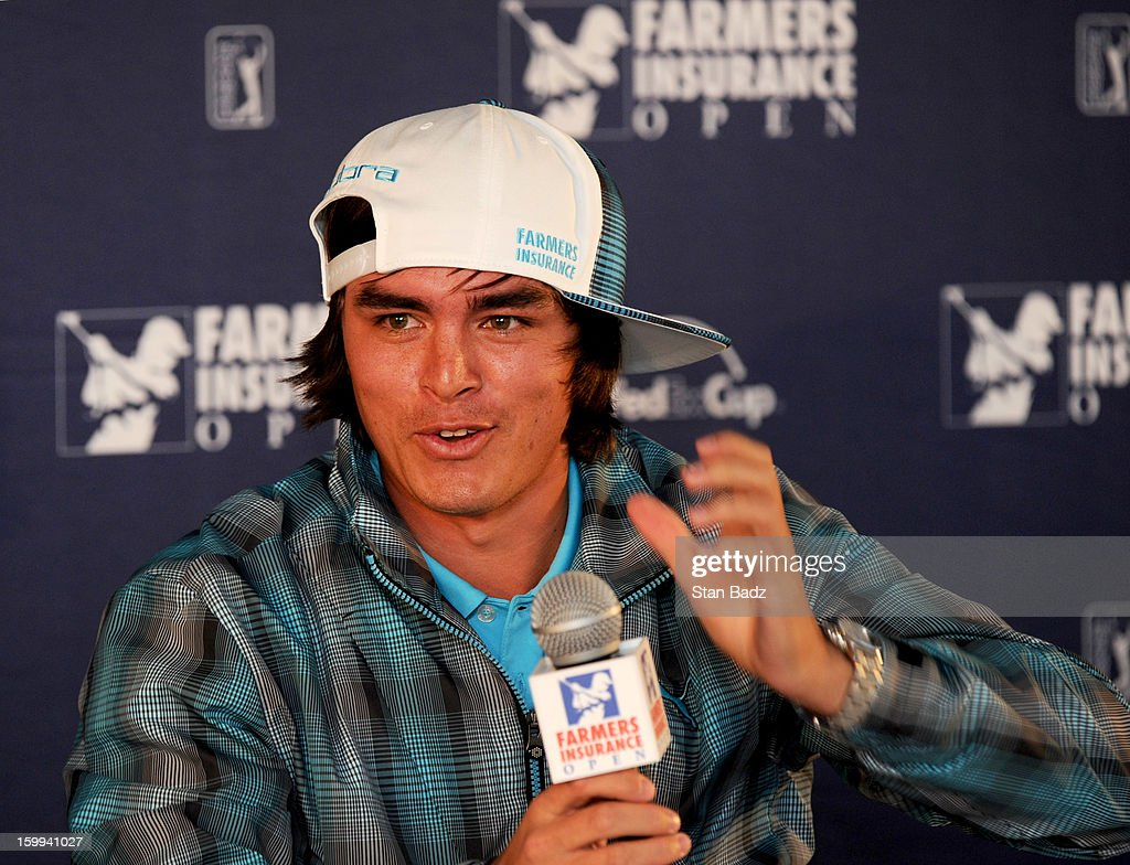 Rickie Fowler turns his cap around featuring a new Farmers Insurance logo as part of his sponsorship agreement announcement during a press interview for the Farmers Insurance Open at Torrey Pines Golf Course on January 23, 2013 in La Jolla, California.