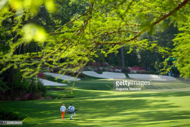 Rickie Fowler walks down Hole No 13 during the final round of the Masters at Augusta National Golf Club Sunday April 8 2018