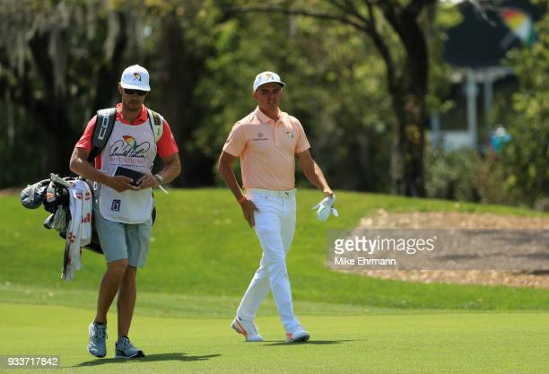 Rickie Fowler walks down the first fairway during the final round at the Arnold Palmer Invitational Presented By MasterCard at Bay Hill Club and...