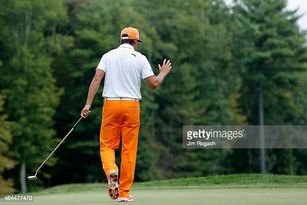 Rickie Fowler walks onto the first hole during the final round of the Deutsche Bank Championship at the TPC Boston on September 1 2014 in Norton...