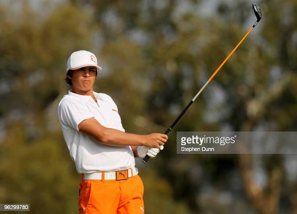 Rickie Fowler watches his his tee shot on the second hole on the South Course at Torrey Pines Golf Course during the final round of the Farmers...