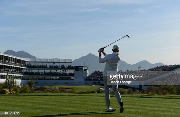 Rickie Fowler watches his tee shot on the 16th hole during the first round of the Waste Management Phoenix Open at TPC Scottsdale on February 1, 2018...