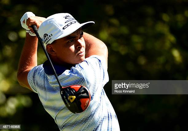 Rickie Fowler watches his tee shot on the fourth tee during round three of the Deutsche Bank Championship at TPC Boston on September 6, 2015 in...