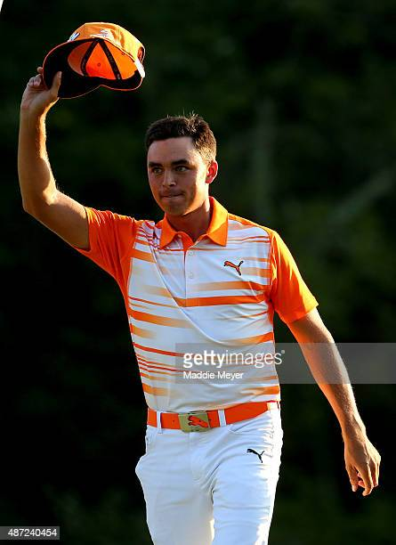 Rickie Fowler waves to the crowd after winning the Deutsche Bank Championship by one-stroke over Henrik Stenson of Sweden at TPC Boston on September...