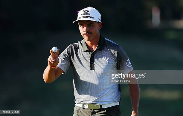 Rickie Fowler waves to the gallery on the 18th green after a threeunder par 68 during the third round of The Barclays in the PGA Tour FedExCup...