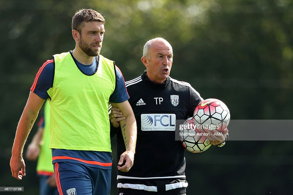 Rickie Lambert and Tony Pulis the head coach / manager of West Bromwich Albion during the West Bromwich Albion training session at West Bromwich Albion Training Ground on September 10, 2015 in Walsall, England.