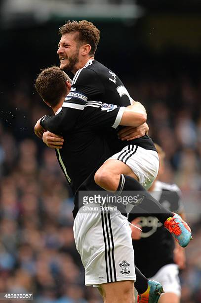 Rickie Lambert is congratulated by teammate Adam Lallana after scoring a goal from the penalty spot to level the scores at 11 during the Barclays...