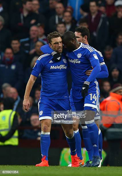 Rickie Lambert of Cardiff City celebrates scoring his sides first goal with team mate Souleymane Bamba during the Sky Bet Championship match between...