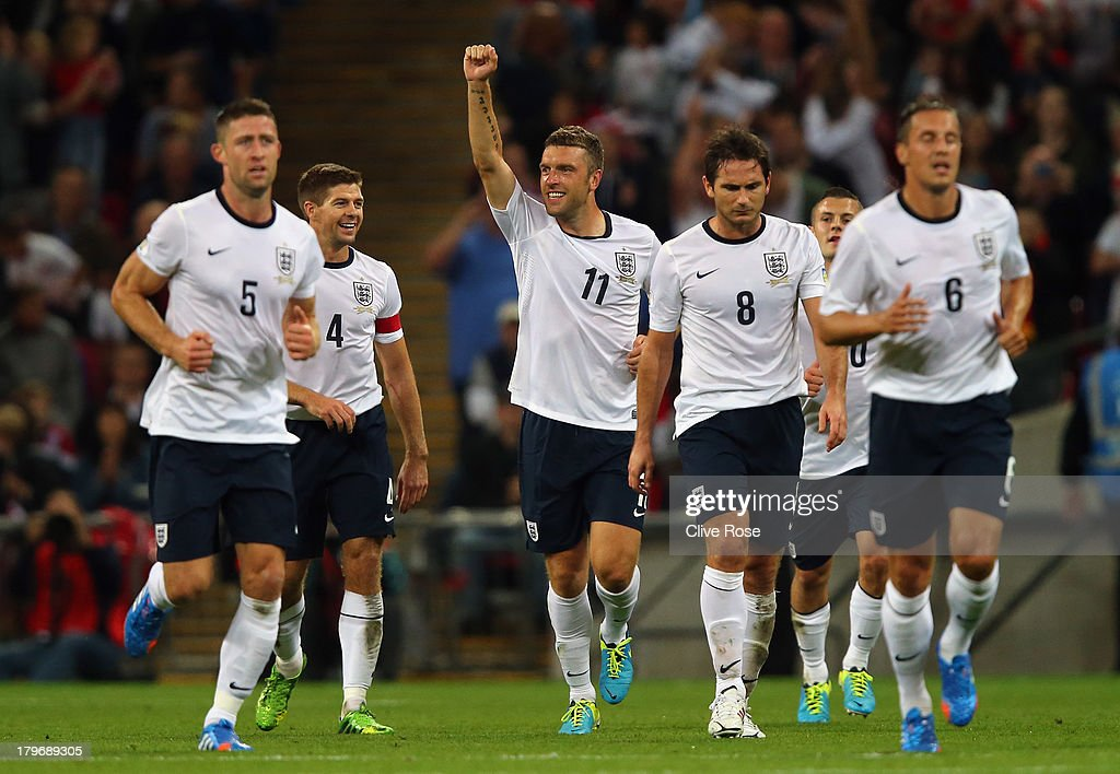 Rickie Lambert of England (C) celebrates scoring their second goal during the FIFA 2014 World Cup Qualifying Group H match between England and Moldova at Wembley Stadium on September 6, 2013 in London, England.