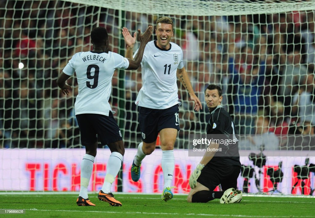 Rickie Lambert of England celebrates scoring their second goal with Rickie Lambert of England during the FIFA 2014 World Cup Qualifying Group H match between England and Moldova at Wembley Stadium on September 6, 2013 in London, England.
