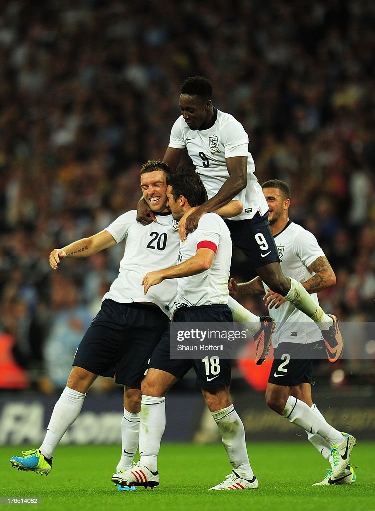 Rickie Lambert of England (L) celebrates with team-mates Danny Welbeck of England (Top) and Frank Lampard of England (2nd L) after scoring a goal during the International Friendly match between England and Scotland at Wembley Stadium on August 14, 2013 in London, England.