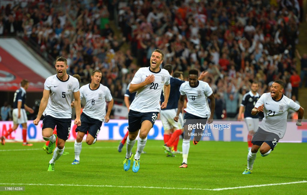 Rickie Lambert of England (C) celebrates with team-mates Gary Cahill of England (L), Danny Welbeck of England (C-R) and Alex Oxlade-Chamberlain of England (R) after scoring a goal during the International Friendly match between England and Scotland at Wembley Stadium on August 14, 2013 in London, England.