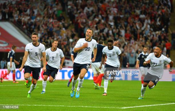 Rickie Lambert of England celebrates with teammates Gary Cahill of England Danny Welbeck of England and Alex OxladeChamberlain of England after...