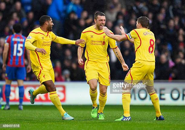 Rickie Lambert of Liverpool celebrates scoring the opening goal with team mates during the Barclays Premier League match between Crystal Palace and...