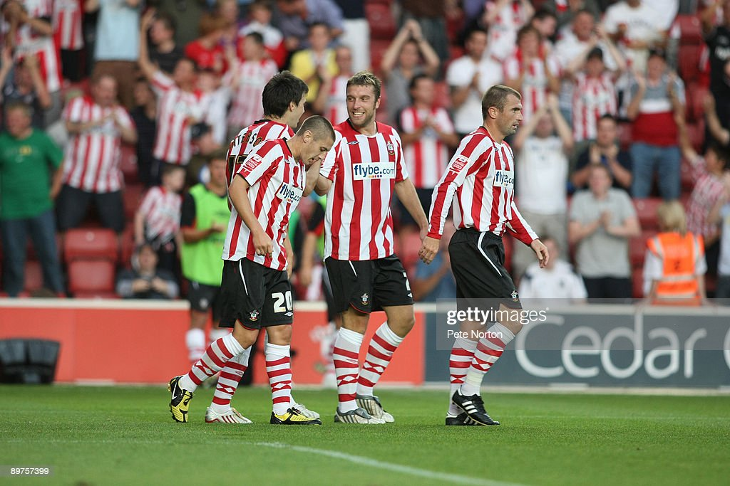 Rickie Lambert of Southampton (C) celebrates after scoring on his debut during the Carling Cup Round One Match between Southampton and Northampton Town at St Mary's Stadium on August 11, 2009 in Southampton, England. Southampton won the match 2-0.