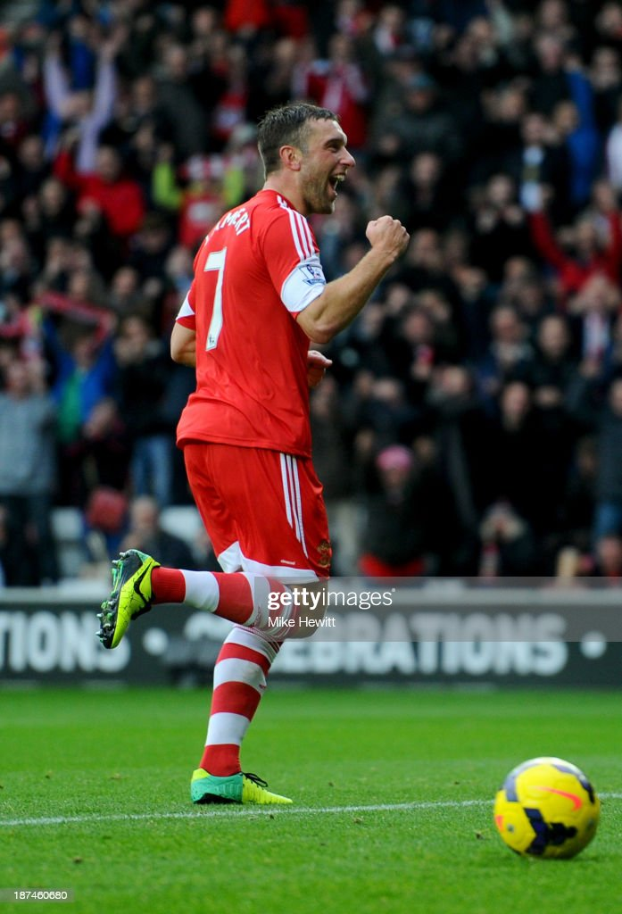 Rickie Lambert of Southampton celebrates as he scores their second goal from a penalty kick during the Barclays Premier League match between Southampton and Hull City at St Mary's Stadium on November 9, 2013 in Southampton, England.