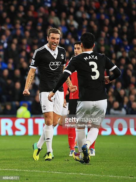 Rickie Lambert of Southampton celebrates his goal with Maya Yoshida during the Barclays Premier League match between Cardiff City and Southampton at...