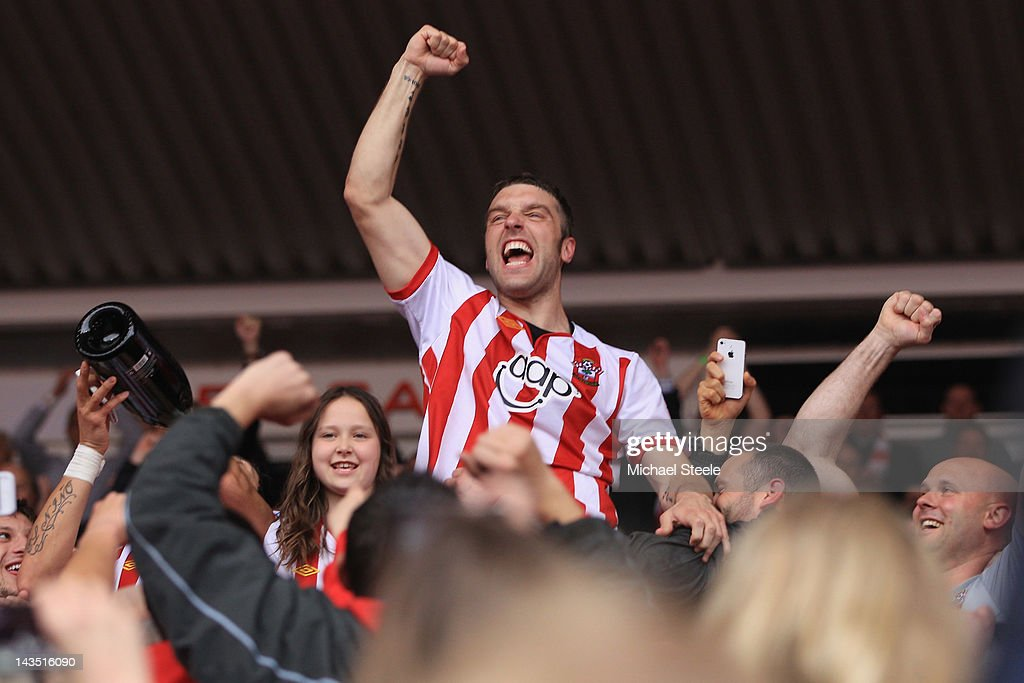 Rickie Lambert of Southampton celebrates promotion after his sides 4-0 victory during the npower Championship match between Southampton and Coventry City at St Mary's Stadium on April 28, 2012 in Southampton, England.