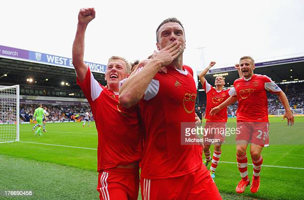 Rickie Lambert of Southampton celebrates scoring the winning goal from a penalty during the Barclays Premier League match between West Bromwich...