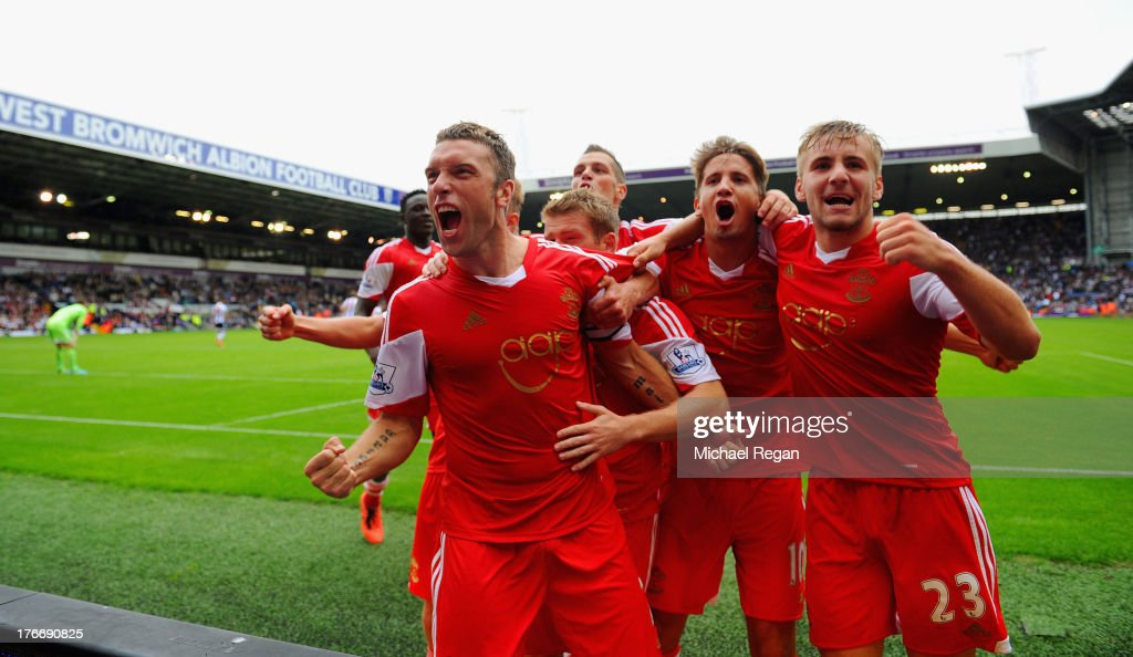 Rickie Lambert of Southampton celebrates scoring the winning goal from a penalty with team matesduring the Barclays Premier League match between West Bromwich Albion and Southampton at The Hawthorns on August 17, 2013 in West Bromwich, England.