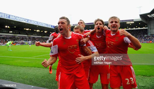 Rickie Lambert of Southampton celebrates scoring the winning goal from a penalty with team matesduring the Barclays Premier League match between West...