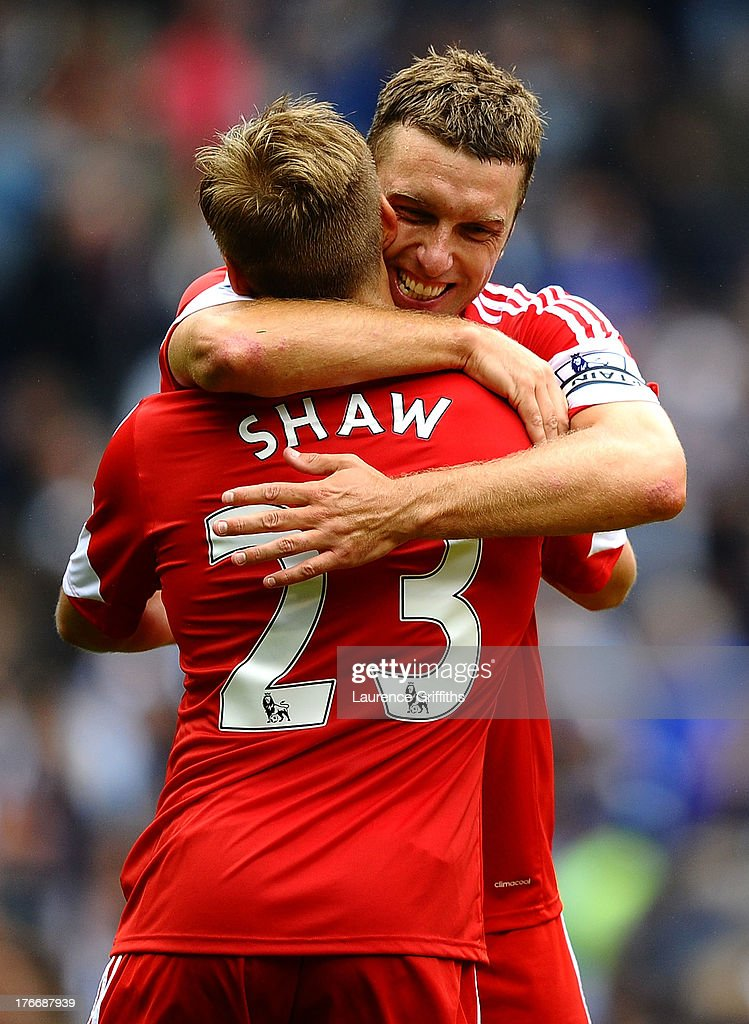 Rickie Lambert of Southampton celebrates victory with Luke Shaw during the Barclays Premier League match between West Bromwich Albion and Southampton at The Hawthorns on August 17, 2013 in West Bromwich, England.