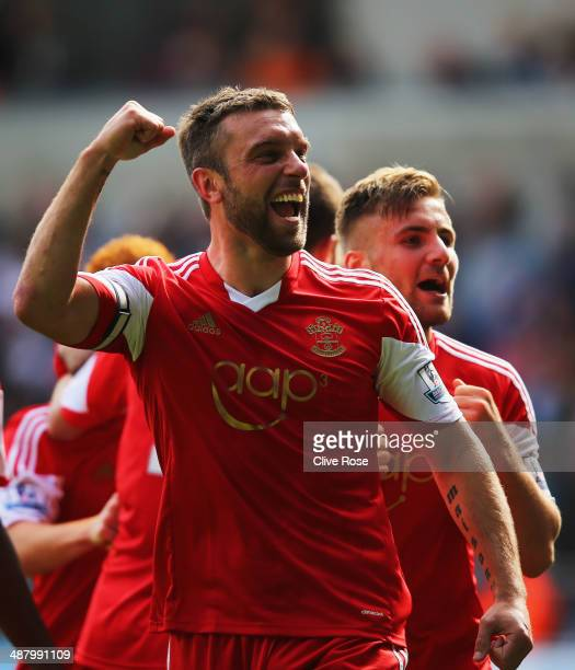 Rickie Lambert of Southampton celebrates with Luke Shaw as he scores their first goal during the Barclays Premier League match between Swansea City...