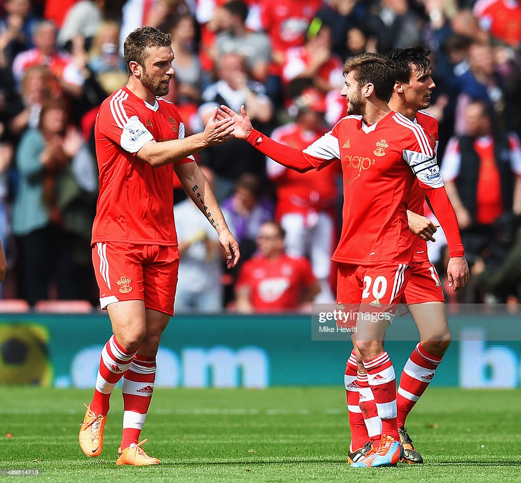 Rickie Lambert (L) of Southampton celebrates with team mate Adam Lallana (R) after scoring during the Barclays Premier League match between Southampton and Manchester United at St Mary's Stadium on May 11, 2014 in Southampton, England.