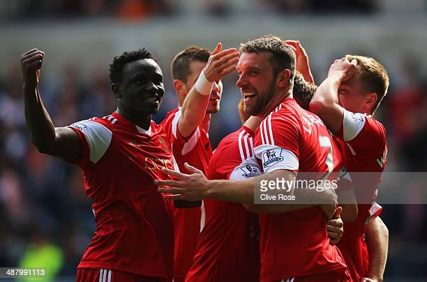 Rickie Lambert of Southampton celebrates with team mates as he scores their first goal during the Barclays Premier League match between Swansea City...